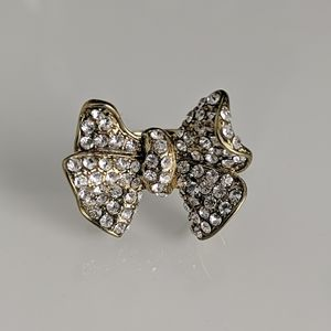 Crystal embedded bow plated gold ring